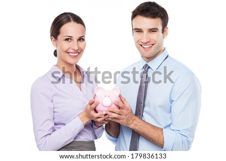 Business people holding piggy bank  - stock photo