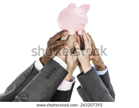 Business people holding piggy bank isolated on white - stock photo