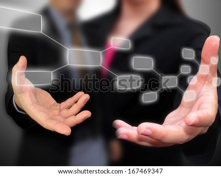 Business people holding touchscreen - stock photo