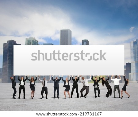 Business people holds a blank banner for your text - stock photo