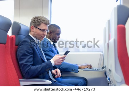Business people in a train - stock photo