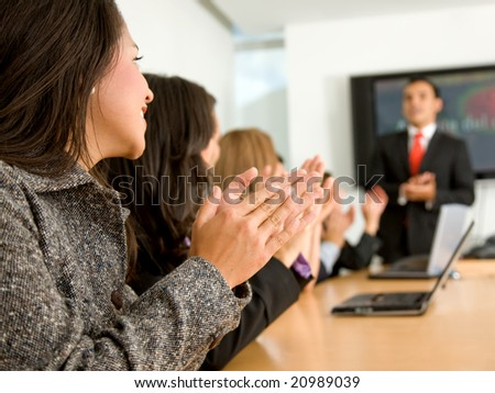 business people in an office clapping a presentation - stock photo