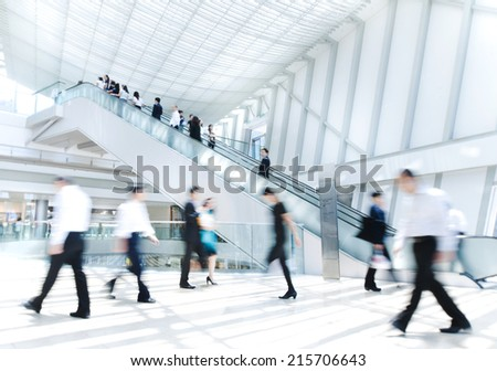 Business People in Asia, Hong Kong. Tilt shift lense with selective focus. Blurred motion. - stock photo