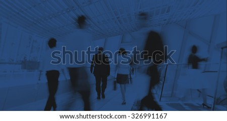 Business people in Asia. Hong Kong.Tilt shift lense with selective focus, Blurred motion. Blue tint. - stock photo