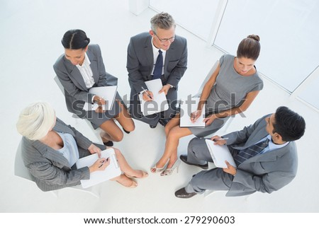 Business people in board room meeting at the office - stock photo