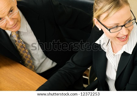 Business people in discussion (focus only on eyes of the woman) - stock photo