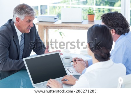 Business people in discussion in an office at work - stock photo