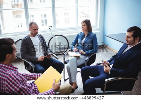 Business people in meeting room at creative office - stock photo