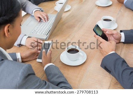 Business people in meeting with new technologies at the office - stock photo