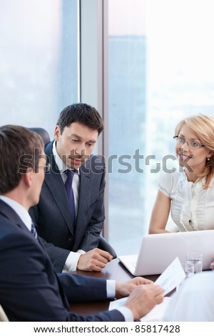 Business people in office meeting - stock photo