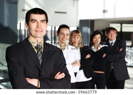 Business people in office (WARNING! Focus only on the man in front of image) - stock photo