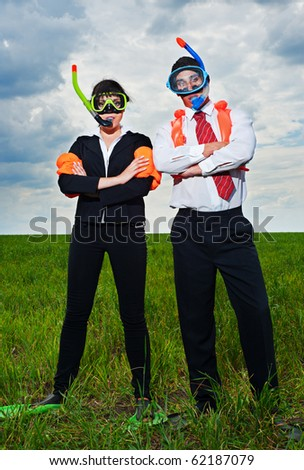 business people in scuba mask and flippers going to vacation - stock photo