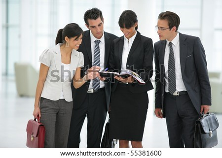 Business people in suit watching documents - stock photo