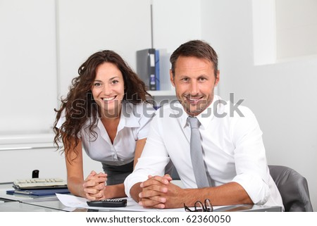 Business people in the office working on building project - stock photo
