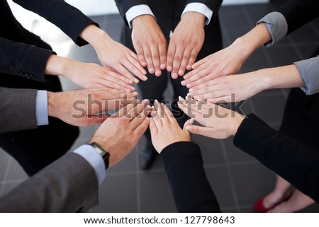 Business people joining hands. Team work - stock photo