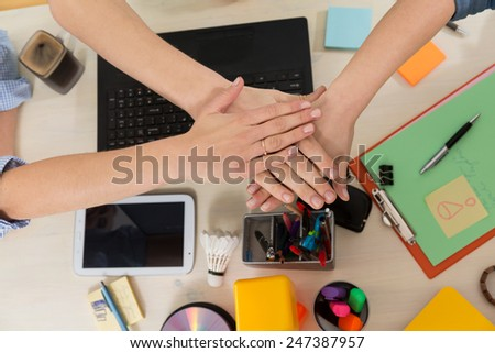 Business people joining hands - teamwork in workplace - stock photo