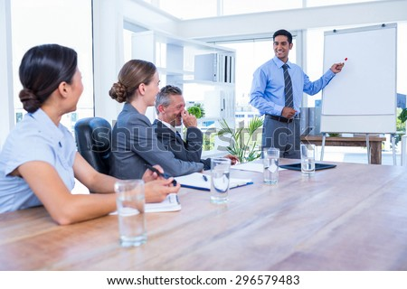Business people listening during a meeting in the office - stock photo