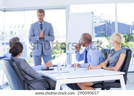 Business people listening during meeting in the office - stock photo