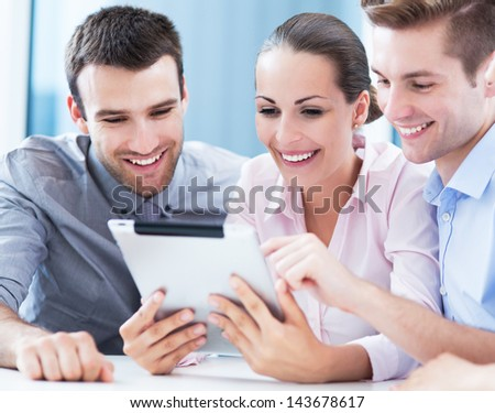 Business people looking at digital tablet - stock photo