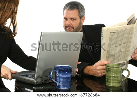 Business people looking at laptop while on break. - stock photo
