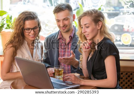 Business people looking at scheme on laptop. Man in navy blue jacket showing his new business project. - stock photo