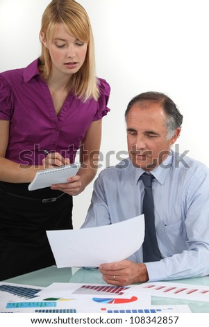 Business people looking at statistics - stock photo