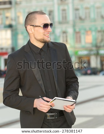 Business people looking. Modern business man. Business documents and contracts in hand. Man in the business center on the background of an office building. Create a portrait of a potential buyer. - stock photo