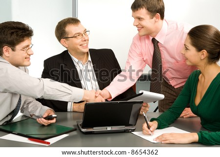 Business people making a successful deal with the partners - stock photo