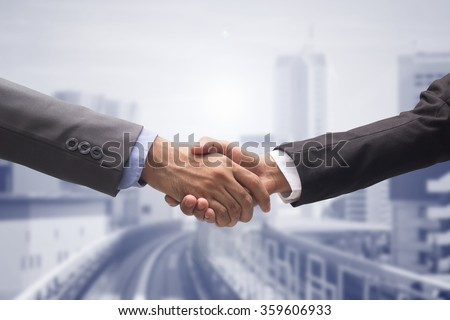business people man handshake on cityscape urban metropolis background:agreement ,accept,approve of financial cooperative concept.improve/development of world class government conception.trust,goal - stock photo