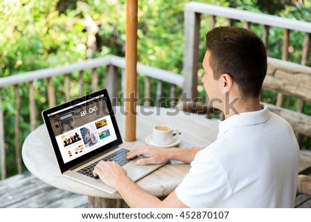 business, people, mass media, internet and technology concept - close up of businessman with blog web page on laptop computer screen drinking coffee on summer terrace - stock photo