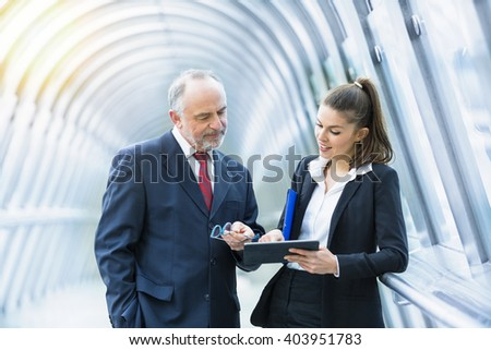Business people meeting and talking in financial district - stock photo