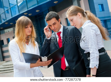 Business people meeting in a modern downtown. - stock photo
