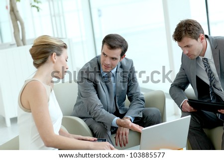 Business people meeting in airport lounge - stock photo