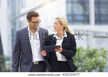 Business people meeting in financial district - stock photo