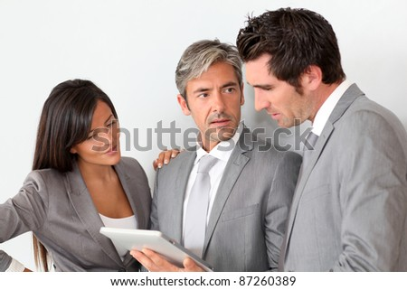 Business people meeting in hall with tablet - stock photo