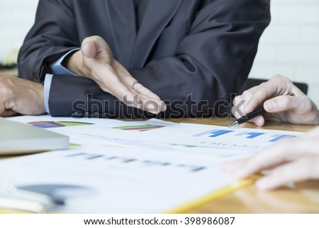Business people meeting to discuss the situation on the market. - stock photo