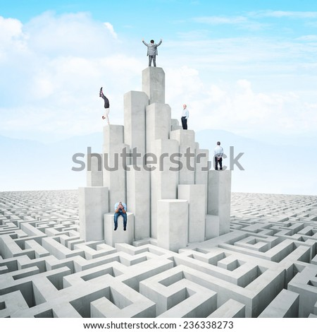 business people on abstract 3d tower with maze - stock photo