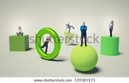 business people on 3d green solid - stock photo