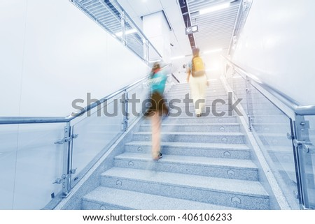 business people on Elevators in metro station - stock photo