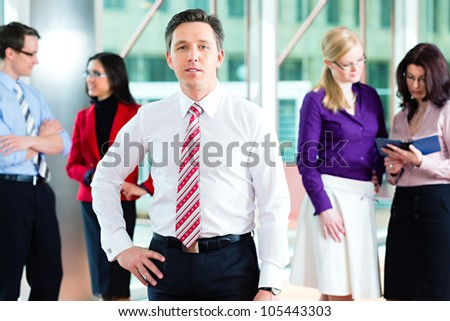 Business people or team in office, a man is looking to the viewer - stock photo