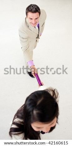 Business people passing a baton in a business building - stock photo