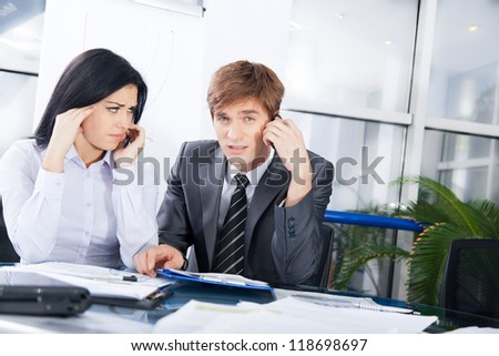 business people phone talk problem negative emotion, businessman call cellphone bad news, stress businesswoman sad terrified, working on meeting sitting at office desk - stock photo