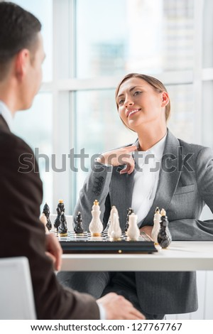 Business people playing chess at office. Business strategy concept - stock photo