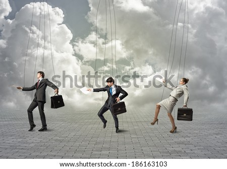 business people puppets hanging by a thread - stock photo