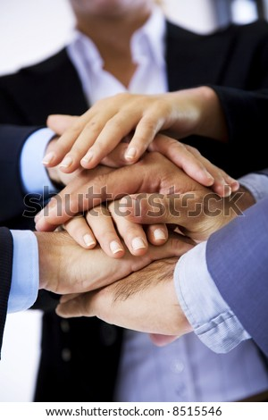 business people putting their hands on top of each other - stock photo