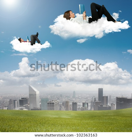 Business people reading book in the sky - stock photo