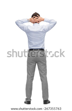 business, people, rear view and office concept - businessman with hands behind his head from back - stock photo