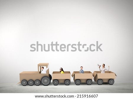 Business people riding carton train. Teamwork concept - stock photo