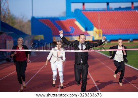 business people running together on  athletics racing track - stock photo