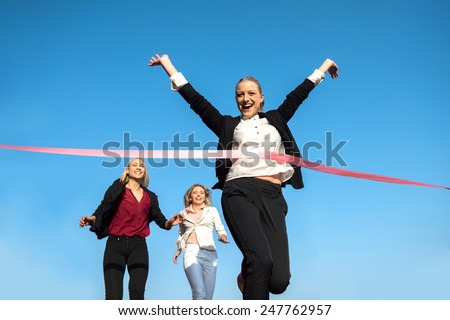business people running together on racing track - stock photo